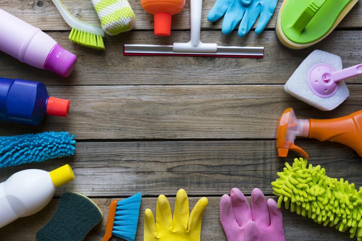 Cleaning supplies around a wooden deck
